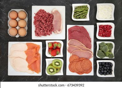 Body building food with meat, fish, dairy, fruit and vegetables in china dishes.