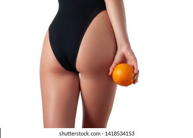 Body care and anti cellulite massage. Perfect female buttocks without cellulite in black underwear.