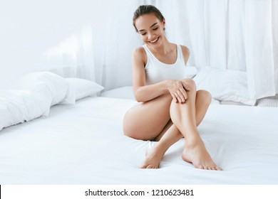 Body Care. Beautiful Woman With Smooth Soft Skin On Long Legs