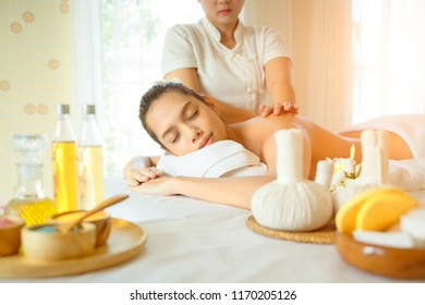 Body care. Beautiful young woman taking spa body treatments and having massage in the spa salon