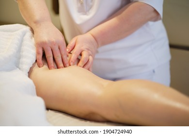 Body care concept. Special anticellulite treatment. Masseur makes anticellulite massage young woman in spa salon. Close up view
