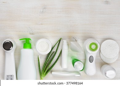 Body care products on wooden background with copyspace at top