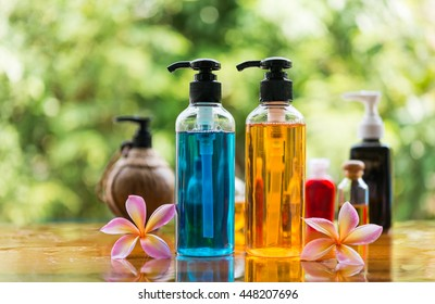 Body care product,shower and shampoo with plumeria flower on nature background