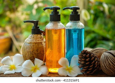 Body care product,shower,shampoo,lotion and Frangipani or plumeria flower on nature background with water drop