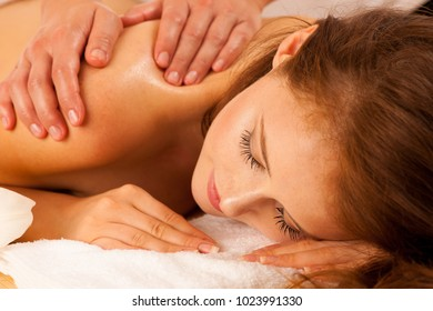 Body care. Spa body massage treatment. Woman having massage in the spa salon. Beb banner dimension image ofmasseur massaging young woman back