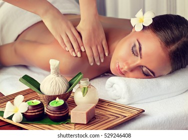 Body care. Spa body massage woman hands treatment. Woman having massage in the spa salon