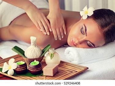 Body care. Spa body massage woman hands treatment. Woman having massage in the spa salon