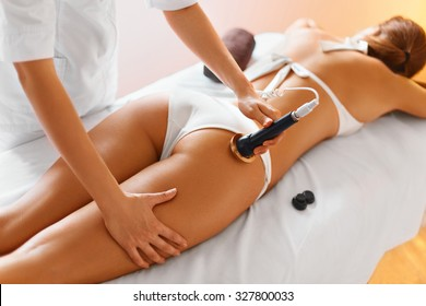 Body care. Ultrasound cavitation body contouring treatment. Woman getting anti-cellulite and anti-fat therapy on her tight buttocks in beauty salon. Spa treatment. Wellness, healthcare, lifestyle.