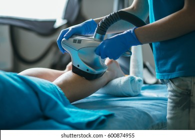 Body care. Ultrasound cavitation body contouring treatment. Woman getting anti-cellulite and anti-fat therapy on her leg in beauty salon. Spa treatment. Wellness, healthcare, lifestyle.