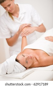 Body care - woman hand massage in day spa salon