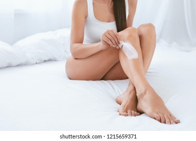 Body Care. Woman Touching Legs With Soft Skin With White Feather