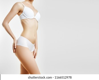 Body care and Women Health. Perfect slim toned young body of the girl. An example of sports, fitness or plastic surgery and aesthetic cosmetology