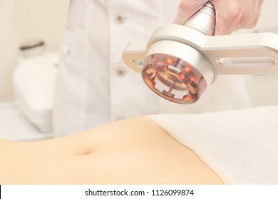 Body cavitation treatment. Ultrasound care to fat reduction. Beauty ultrasonic massage therapy at salon. Anti cellulite.