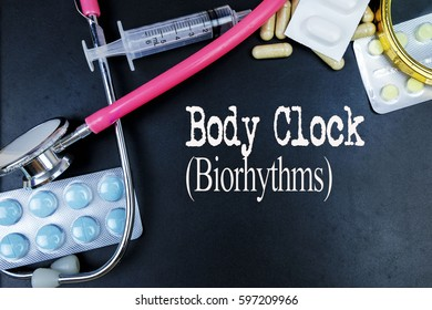 Body Clock (Biorhythms) word, medical term word with medical concepts in blackboard and medical equipment.