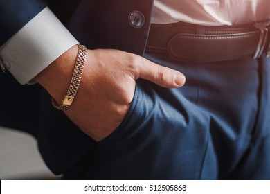 body detail of a business man. Closeup hand with jewelry chain in pocket