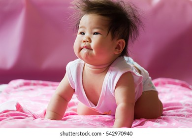 body five months old East Asian baby girl crawling