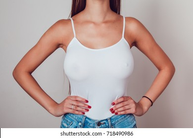 Body of a girl with big breasts in a white tank top. Mock up.