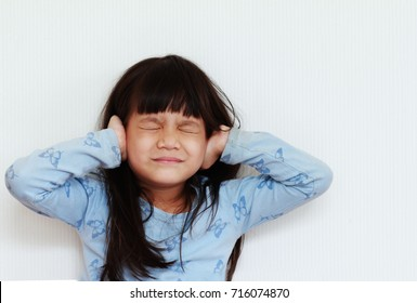 Body language saying of 5 year old Asian girl.Girl close her ears and close the eyes.Body language means of expression.Do not want to hear,do not want to know or do not want to do or any acknowledge