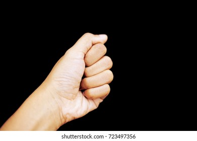 Body language symbol with hand and finger of Asian woman. Blur finger print. Isolate black background. Brown color skin.