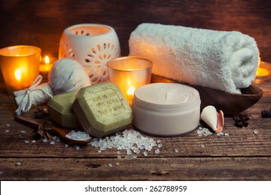 Body lotion, soap and towel on a wooden surface, Spa still life