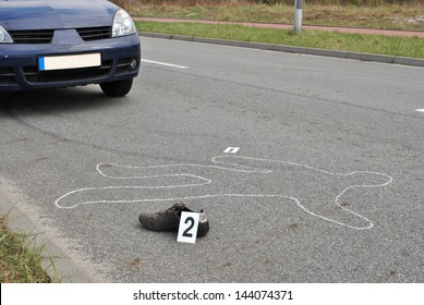Body of a man on the street  hit by the car