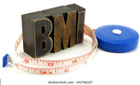 Body Mass Index (BMI) concept using vintage letter press letters and medical tape.
