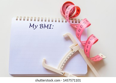 Body mass index BMI. Body mass index formula rate in a notepad. Concept BMI body mass index formula rate formula, fitness and weight loss. Note written: BMI (body mass index) formula, health concept