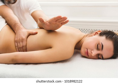 Body massage at physiotherapist office. Young woman getting professional spine and back treatment. Rehabilitation, medical massage and manual therapy concept