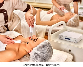 Body massage of silver threaded gloves at beauty salon. Electric stimulation skin care of man. Professional equipment for microcurrent lift. Modern technologies. Best spa clinic.