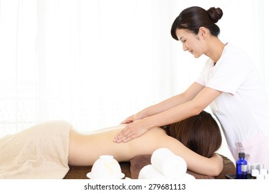Body massage at spa salon