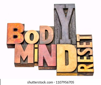 body and mind reset - isolated word abstract in vintage letterpress prinitng blocks, mixed fonts