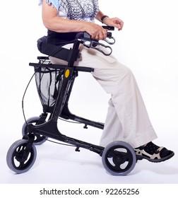 Body part of elderly woman sitting on a modern walker