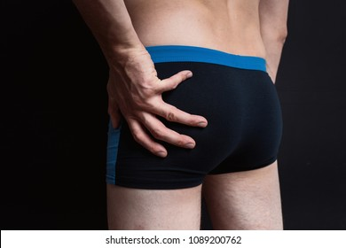 body parts: men's ass in underwear. inflated buttocks in boxer shorts. elastic muscles after exercise and diet. concept: diseases of the anus, constipation and male problems