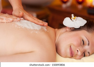 Body peel using coarse marine salt in a health centre or spa with the salt crystals used as an exfoliator and to replace essential minerals