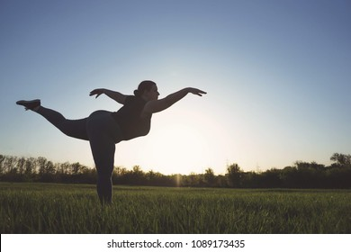 Body positive, confidence, high self esteem, free your mind concept. Overweight woman dancing outdoors, copy space