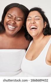 Body positivity women laughing happy plus size model posing