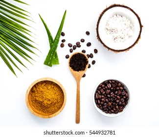 Body scrub of ground coffee, sugar and coconut on white background, homemade cosmetic for peeling and spa care,keep the moisture of your skin.Good and easy spa product you can make at home.