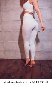 Body of a sexy girl with huge breasts in a white top and leggings. Mock-up.
