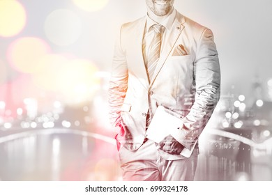 Body shot of businessman holding a tablet pc double exposure