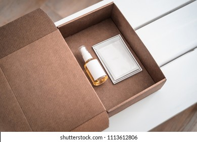 Body, skincare products in craft paper beauty box. Mask, oil, scrub, cleanser, anti ageing treatment. Beauty industry, branding mockup, packaging design. Minimalism concept