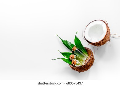 Body treatment. Coconut lotion on white background top view copyspace