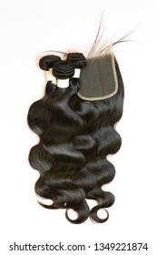 Body wave black virgin human hair extensions bundles with 4x4 lace closure- Image