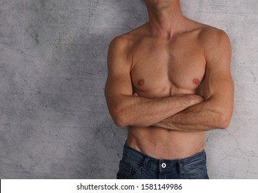 Body Waxing For Man . Attractive male body , Muscular torso, Chest and armpit hair removal close up.