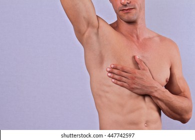 Body Waxing For Man . Attractive male body , Muscular torso, Chest and underarms hair removal close up.