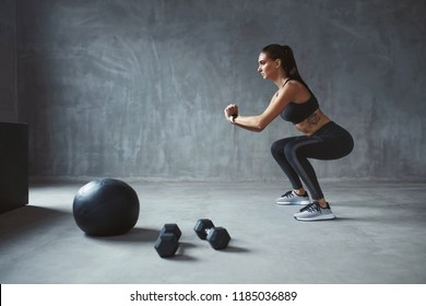 Body Workout. Fitness Woman In Stylish Sports Clothes Exercising