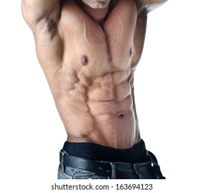 Bodybuilder with arms over his head showing torso - isolated on white