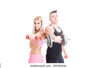 Bodybuilder boyfriend with sexy fitness girlfriend holding weights  isolated on white