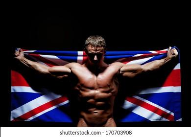 Bodybuilder carrying the flag of UK