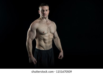 Bodybuilder concept. Bodybuilder man with strong body. Bodybuilder with six pack and ab muscle. Sexy bodybuilder with muscular torso. Bodybuilding, copy space.