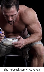 Bodybuilder eating rice